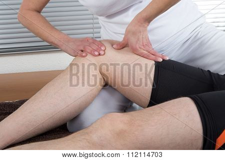 Massage Therapist Working On Man Leg At Heath Center
