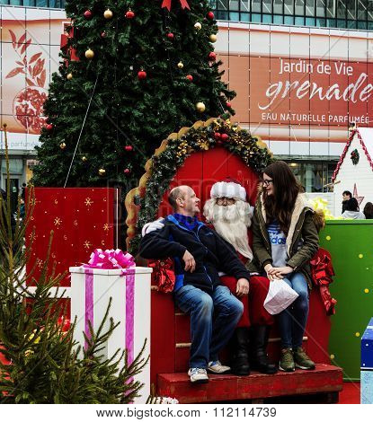The Unidentified Tourists With  Santa Claus At Christmas Market In Puteaux City, France.
