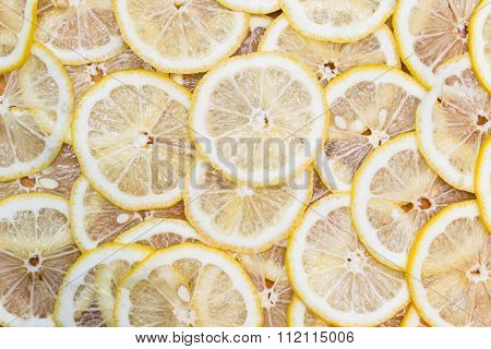 background made with slices of yellow lemon