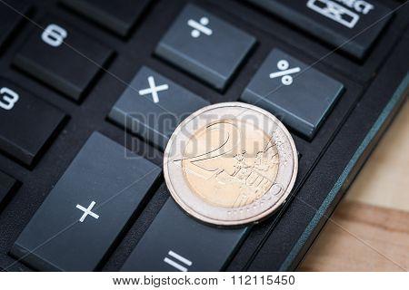 Calculator And 2-euro Coin