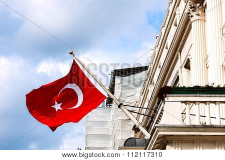 Turkish flag waving from the embassy balcony in London exterior view front entrance outdoors