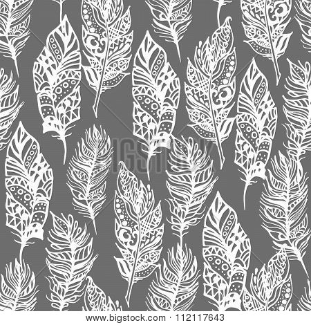 Hand drawn vector zentangle doodle white feathers seamless pattern on grey.