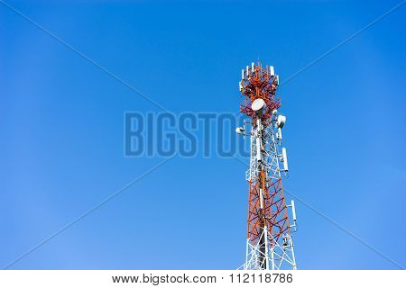 Mobile (cellular) Tower Antennas With Blue Sky Background.