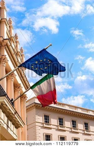 Italian and European Union flags waving from the embassy balcony in London exterior view outdoors fr