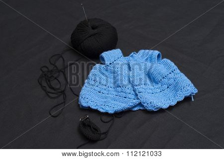 blue dress made of wool to crochet rag dolls