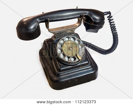 Old Rotary Phone On A White Background.