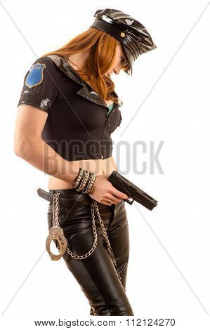 attractive woman in costume policewoman with a gun in hand