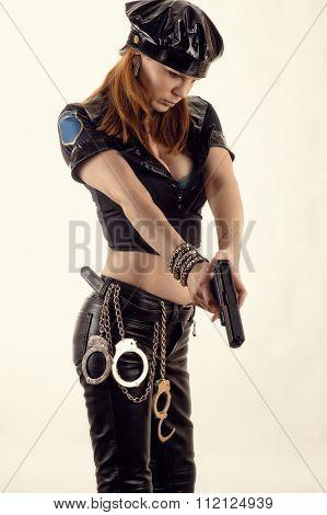 beautiful police woman aiming a pistol