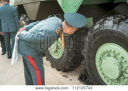 Officer of Kazakh army examine troop-carrier