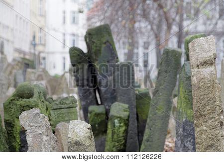 PRAGUE CZECHIA - DEC 04 2015: Old Jewish cemetery close-up of ancient headstones. Short depth of focus. December 04 2015 in Prague Czechia