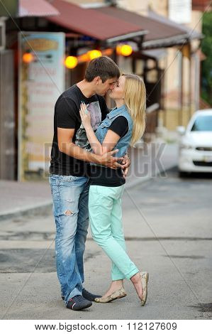 Loving Couple On A Walk Through The City Streets