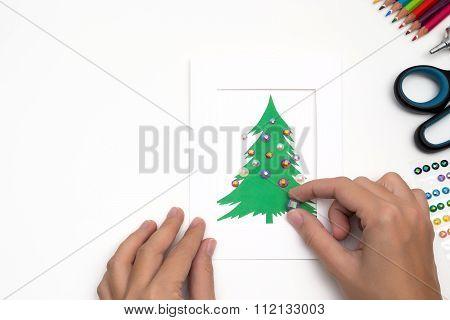 Girl Is Decorating Christmas Card. Handmade