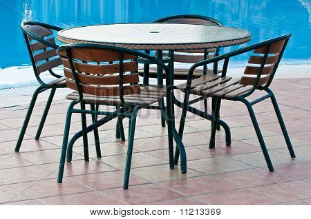 Table And Chairs By The Pool