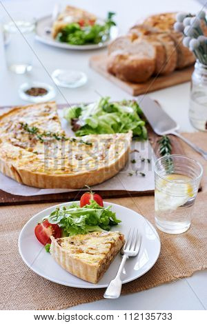 Lunch time meal with quiche and side salad, simple snack food