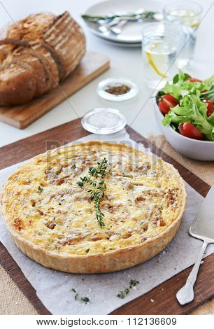 Quiche lorraine tart frittata pie light meal for lunch served with green salad and loaf of bread
