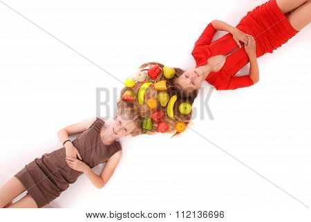 Portrait Two Girls With Intertwined Hairs And Fruits