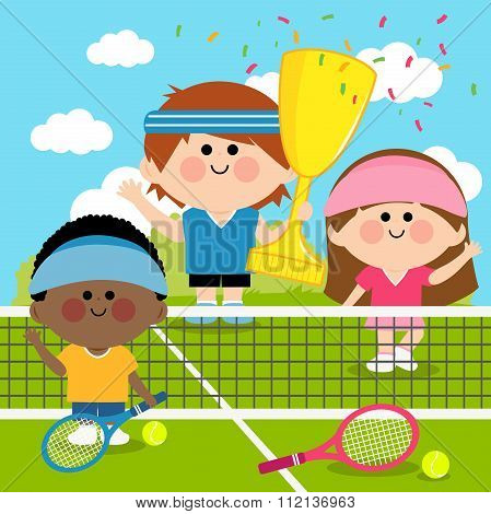 Champion kids tennis players at tennis court holding trophy