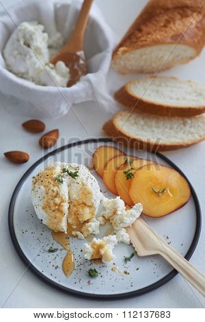 Fresh ricotta cottage cheese drizzled with honey, snack starter appetizer canape with sliced peach nectarine and bread