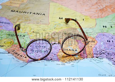 Glasses on a map - Ivory Coast