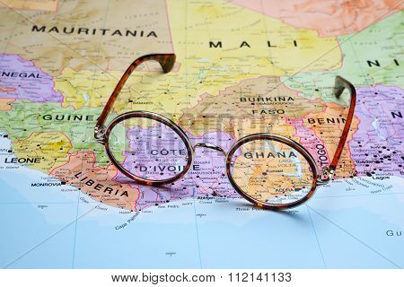 Glasses on a map - Ghana