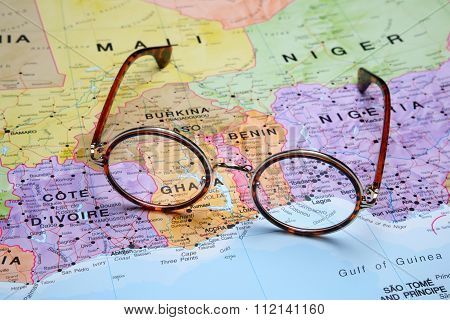 Glasses on a map - Porto Novo