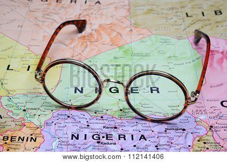Glasses on a map - Niger