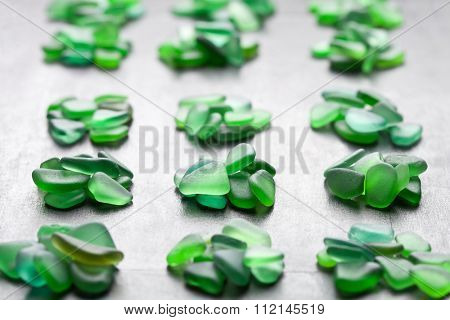 green pieces of glass polished by the sea closeup on black background