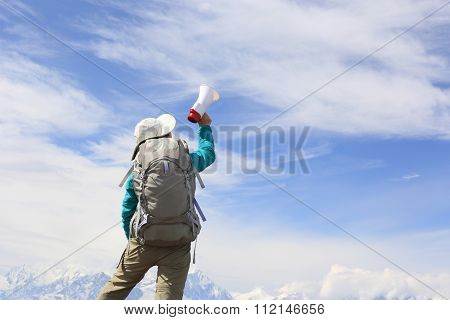 hiker hiking on mountain peak enjoy the view