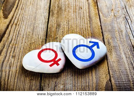Male And Female Symbols On Hearts. Sing Venus And Mars.