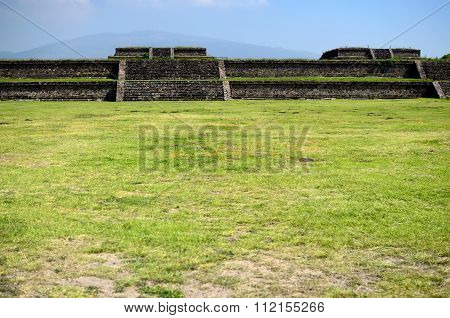 Green Grass Field And Teotihuacan Ruins