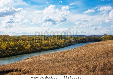 River Landscape With White Clouds