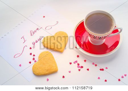 Declaration of love, a cup of tea and biscuits in the shape of a