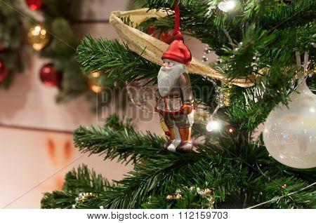 Santa Claus Doll Against A Christmas Tree