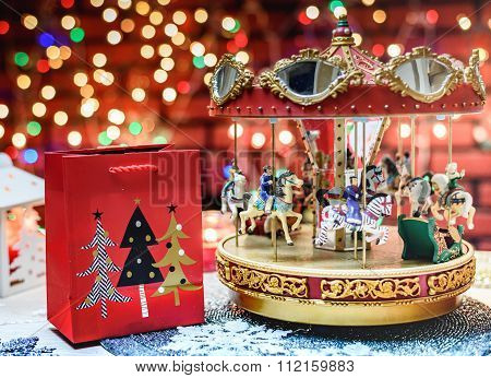 Merry Go Round And Chistmas Present On The Colorful Background