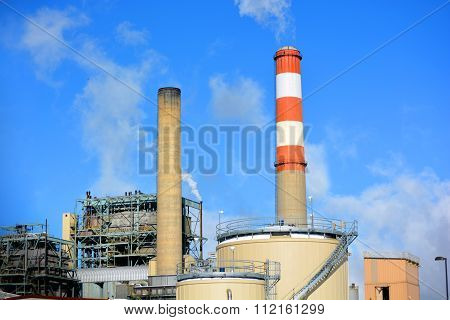 Coal Fossil Fuel Power Plant Smokestack With Red And White Color
