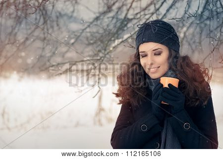 Winter Woman Holding a Hot Drink Mug