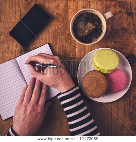 Woman Writing In Notebook During Breakfast, Top View
