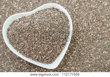 Chia Seeds In White Bow Heart Shape.