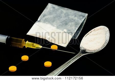 Drug Syringe, Amphetamine Tablets.