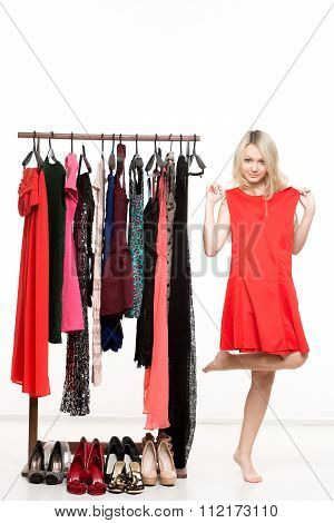 girl in underwear from clothes hangers. Isolated white background. choice of dress