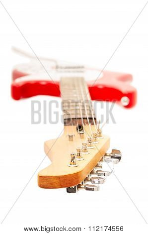 Electric guitar, neck in the foreground