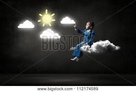 Little cute girl sitting on cloud and pointing with finger