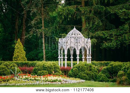 Gazebo in green spring summer garden