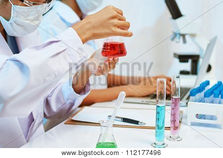 scientists experimenting in laboratory