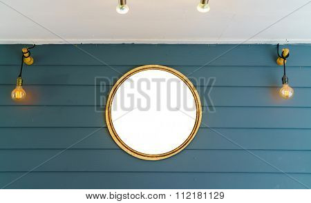 Wooden signboard with light bulb hanging on planks background