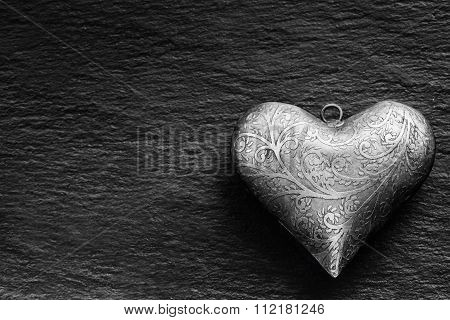 Valentine Metal heart on a granite board. Valentine's two silver heart with ornament