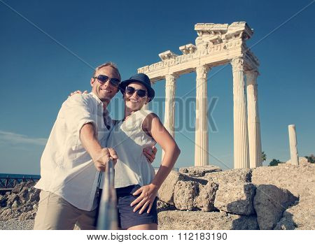 Smiling Young Couple Take A Selfie Photo On Antique Ruins