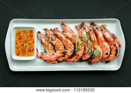 Fresh Grilled Shrimps, Top View On Blak Background.eat With Spicy Seafood Sauce