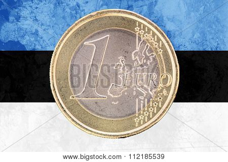 One Euro Coin On The Flag Of Estonia As Background