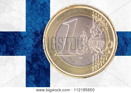 One Euro Coin On The Flag Of Finland As Background